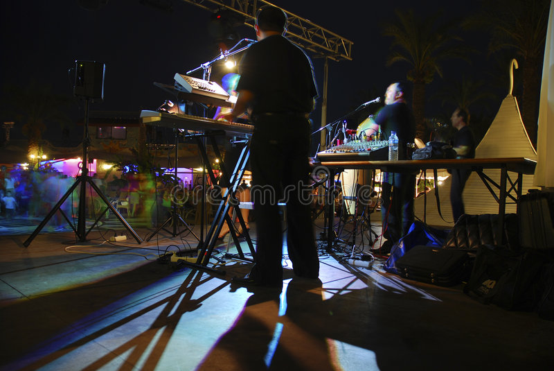 Night concert. And dancing people royalty free stock photos