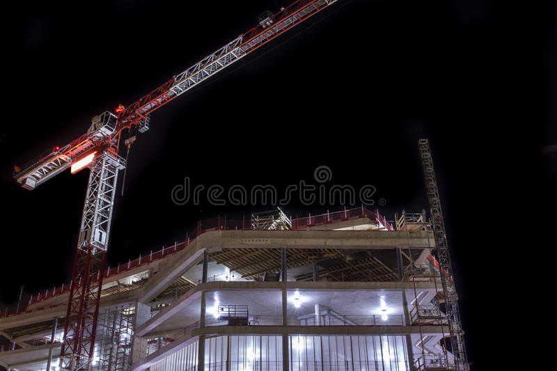 Night construction. Nightime construction with a crane royalty free stock image