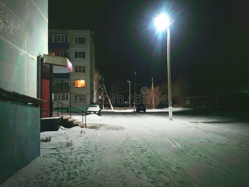 Night light in winter evening. Night court of the Russian street in winter lantern Night light in winter evening royalty free stock photos