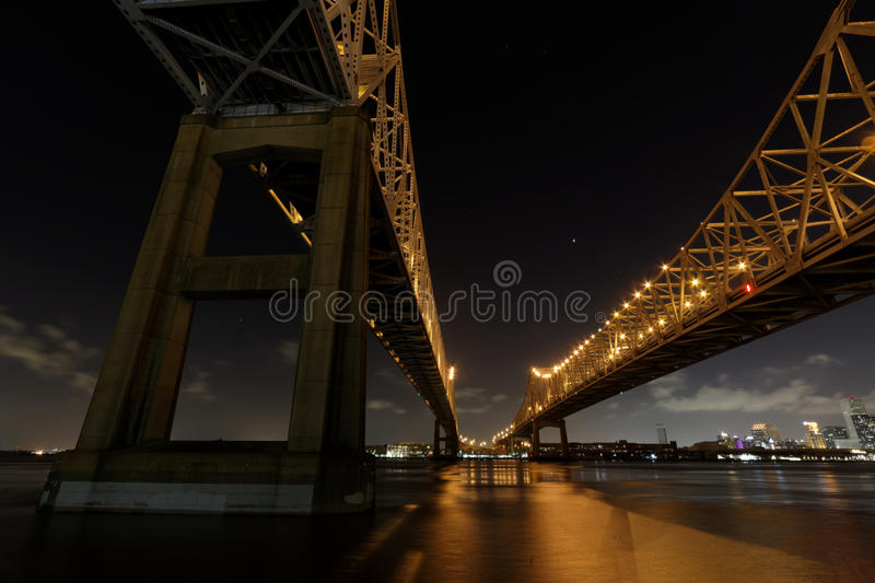 Night on Crescent City Connection Bridges in New Orleans. The Crescent City Connection Bridge on the Mississippi river by night stock photo