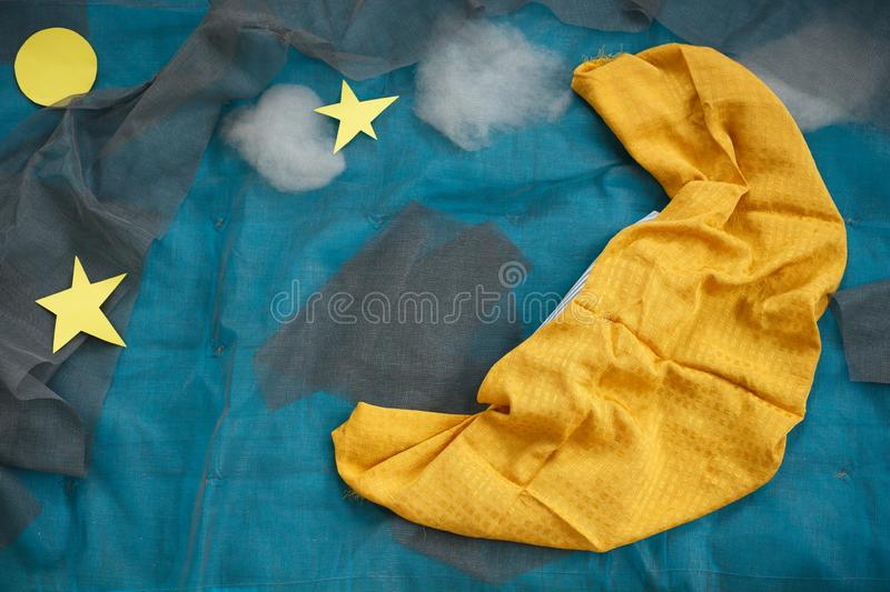 Night decorations of moon and stars for newborn photography. Baby photo decor. Night and sleep concept for children. Textiles for babies. Blues and yellow royalty free stock photography
