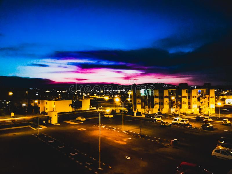 Night deparment. Purple sky smoke royalty free stock photography