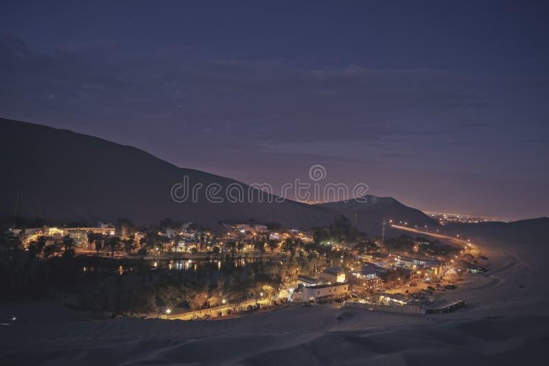 The night desert and oasis view of Huacachina, Ica, Peru. stock photo