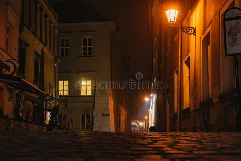 Night european ancient narrow street. With warm illumination stock photography