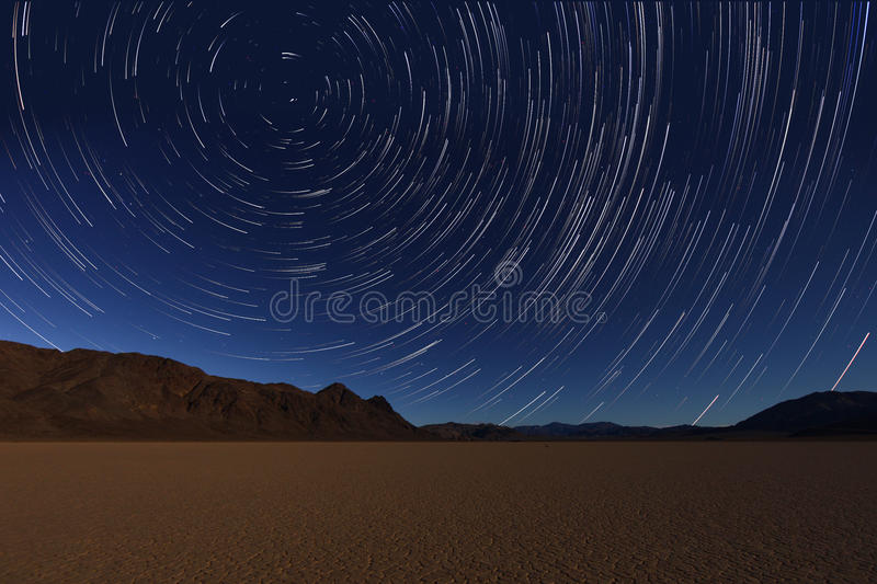Night Exposure Star Trails of the Sky in Death Valley California stock photography