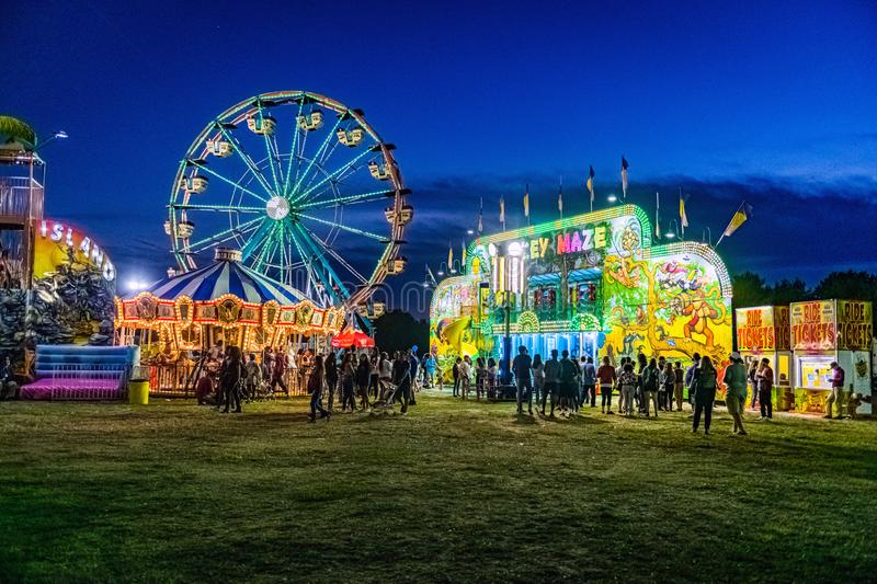 Night at the Fair. WEST WINDSOR, NEW JERSEY -SEPTEMBER 29: A crowd of people enjoy a night at the Mercer County Italian American Fest on September 29 2019 in royalty free stock images