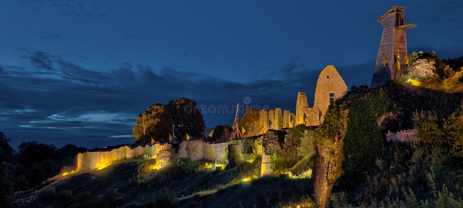 The night falls on the medieval fortress in Tiffauges stock photo