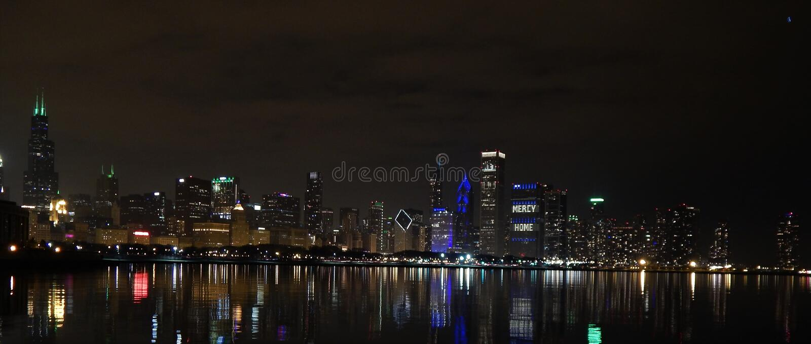 Night falls over the city. Of Chicago in this view from the Adler Planetarium Skyline Walk. Highlights include the Sears Tower, John Hancock Center. Trump royalty free stock image