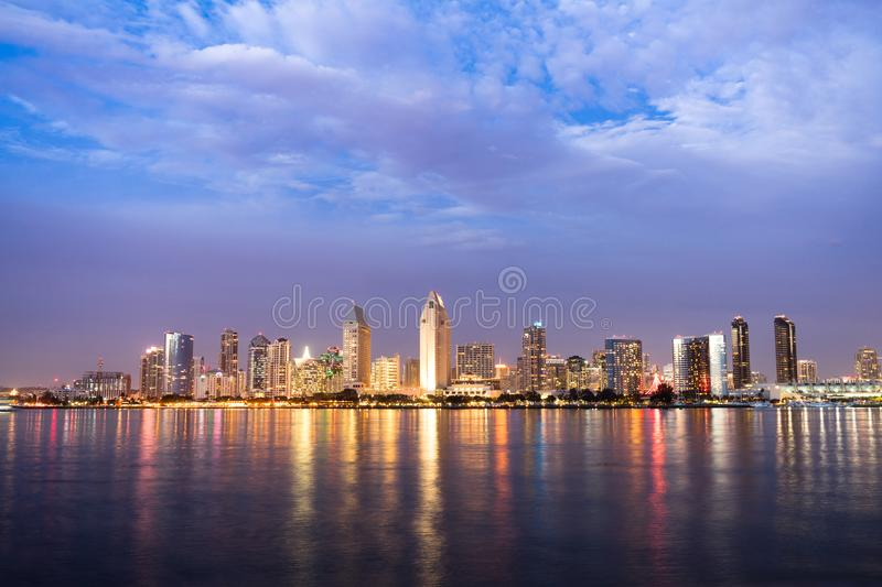San Diego Skyline Downtown City Waterfront Coronado Island. Night falls on San Diego California as the bay reflects lights from buildings downtown royalty free stock image