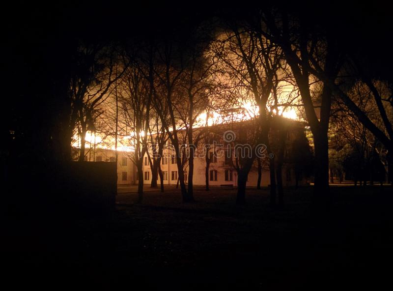 Night fire. Building, trees, smoke stock images