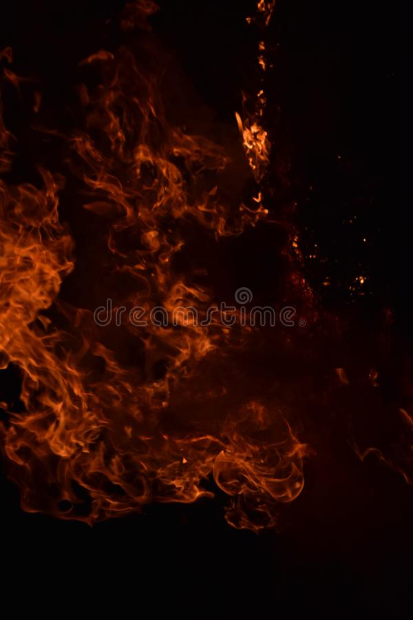 The night fire. Night fire. Burning of rice straw at night stock image