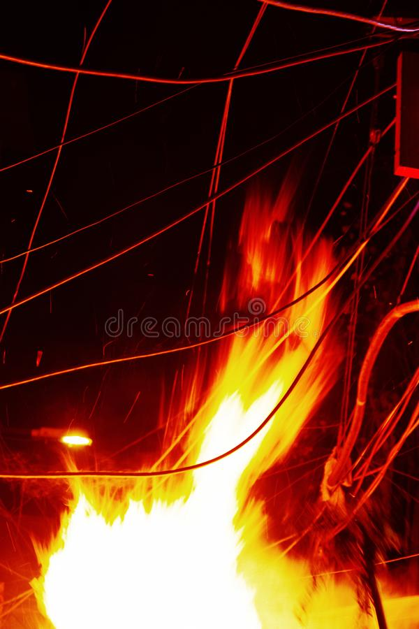 The Night fire in the city. Burnt electrical wires royalty free stock photos