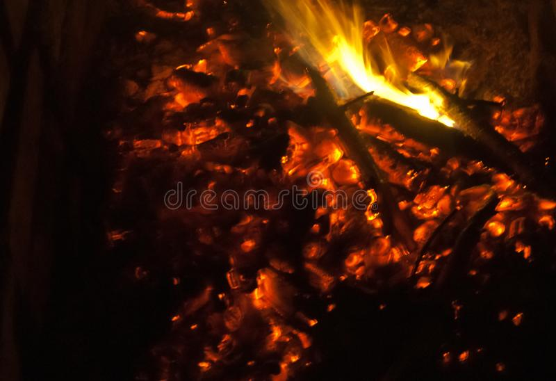 Bonfire in the night. Fire and coals. The flame attracts the eye. Bonfire burns at night. Fire hugs firewood. Bonfire almost burned out stock photography