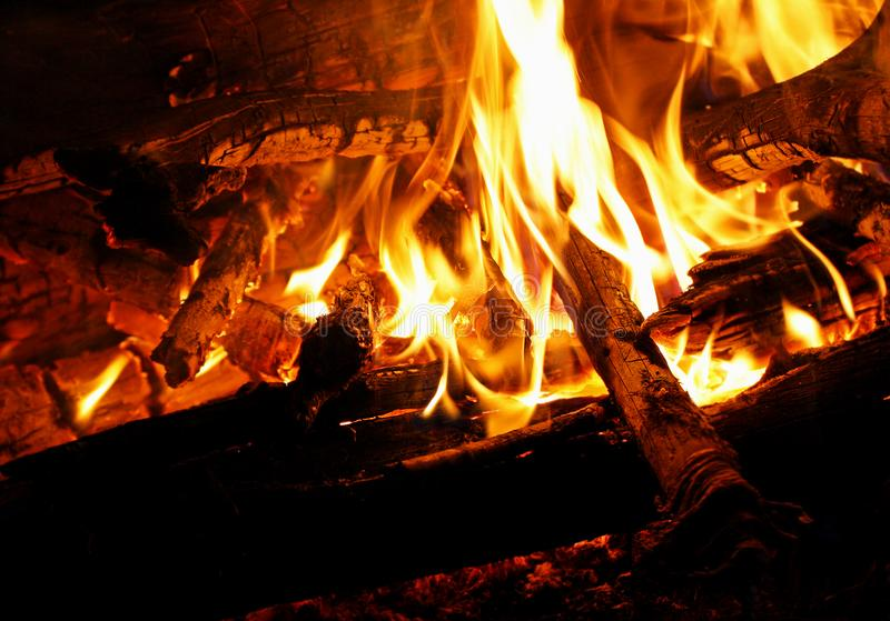 Night fire. The flame in the embers close up stock photography