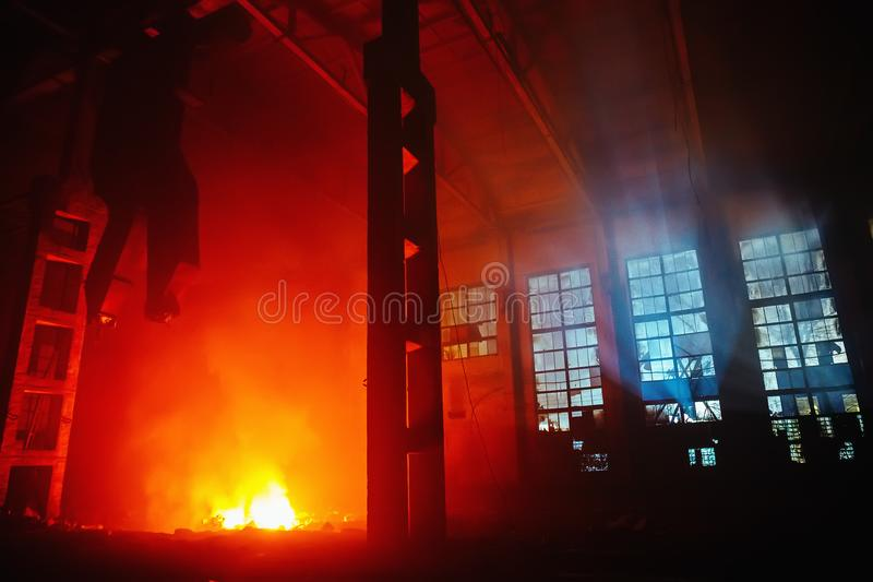 Night fire inside a large workshop of an industrial factory or warehouse, an industrial accident insurance royalty free stock photography