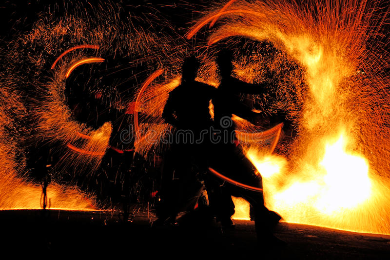 Night fire show. Night fire man show of two people stock photo