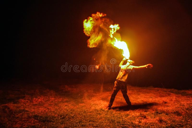 Night fire show. Amazing night paty fire show on black background royalty free stock images
