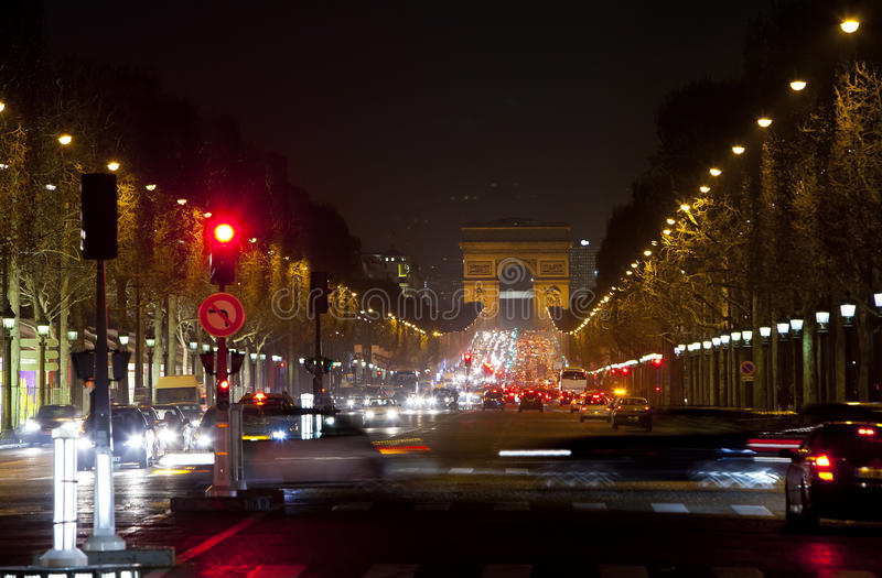 Night fires of cars on the Champs Elysee. Paris.  royalty free stock photo