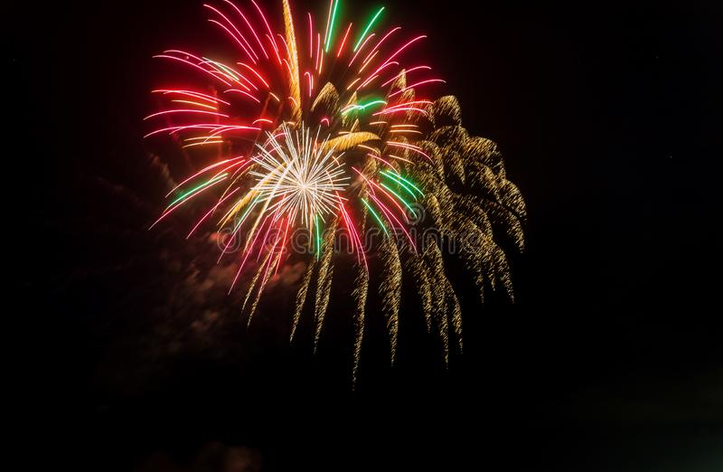 Night fireworks different colors on a black background royalty free stock photography