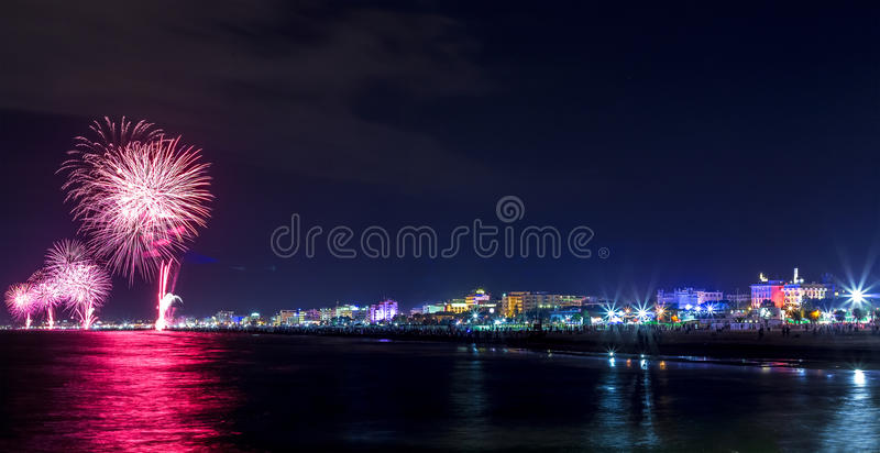 Night fireworks explosion on seafront. Rimini Notte Rosa. Fireworks explosion for celebrating Rimini Notte Rosa stock images