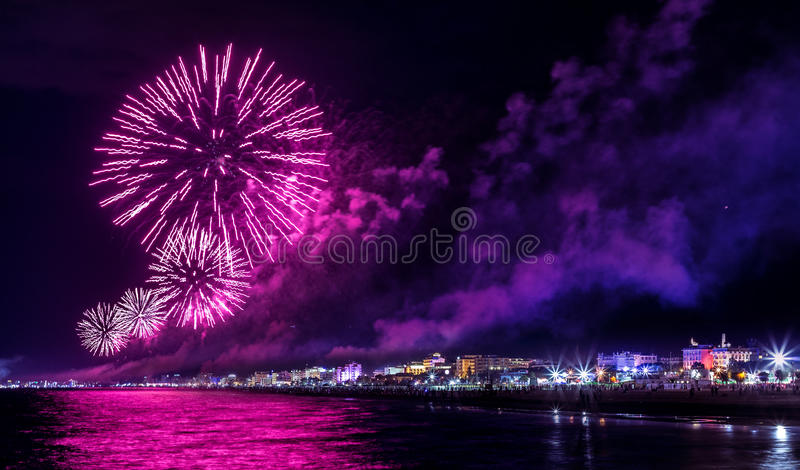 Night fireworks explosion on seafront. Rimini Notte Rosa royalty free stock image