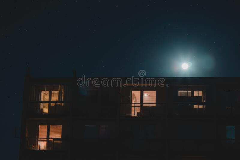 Night flats full moon summer mood. Full moon balconies stock photos