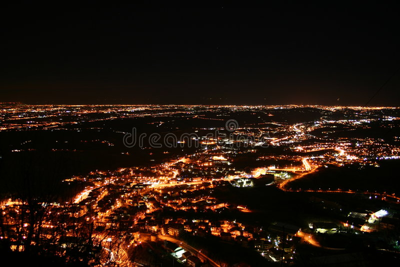 Night flight city lights in a valley royalty free stock images