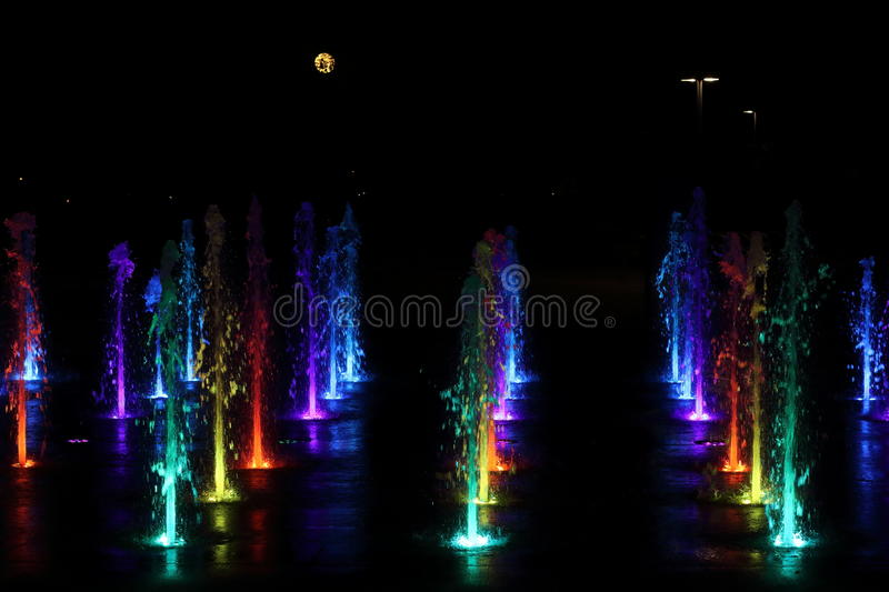 Night Fountain. Water fountain park in Minnesota with moon in background stock images