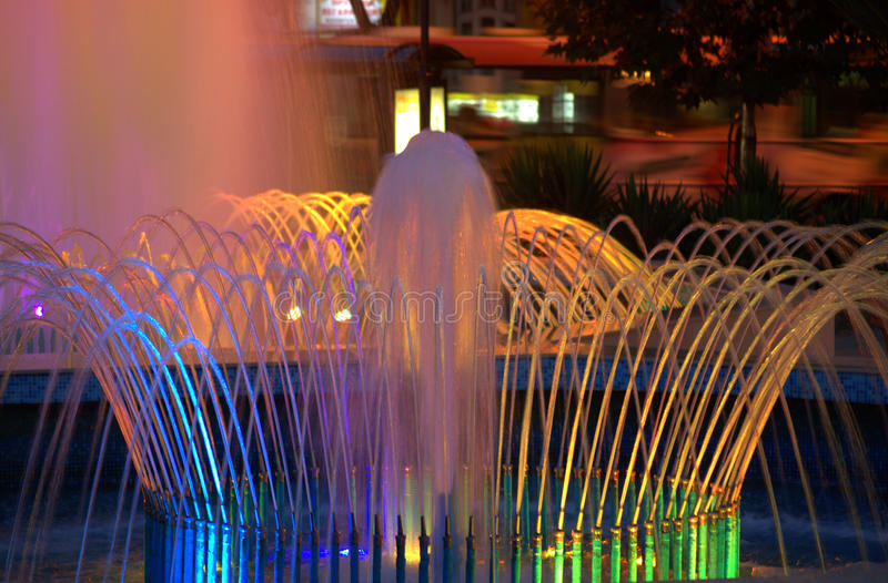 Night fountains. Bright colorful city fountains at night stock image