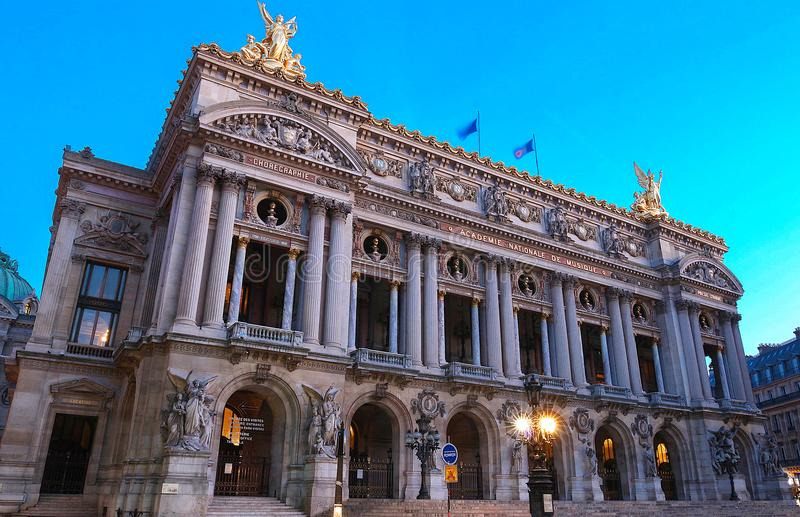 Night front view of the Opera National de Paris. Grand Opera is famous neo-baroque building in Paris. Night front view of the Opera National de Paris. Grand royalty free stock photography