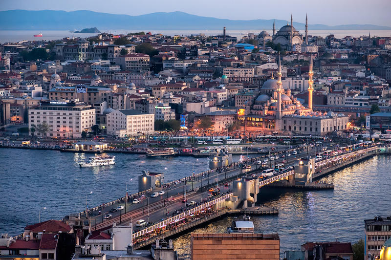 Night Galata Bridge. Istanbul, Turkey - April 16, 2016: Galata Bridge on the Golden Horn, with Eminonu district in the background, as seen from the Galata Tower royalty free stock photography