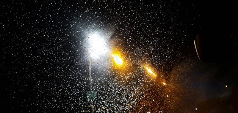 Night gleam raindrops royalty free stock image