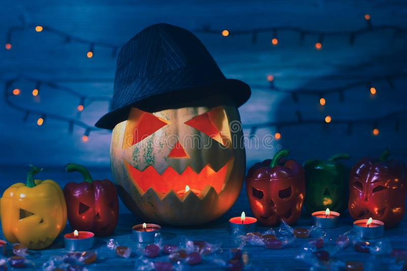 Night before Halloween. Jack lantern in hat and his friends are stock image