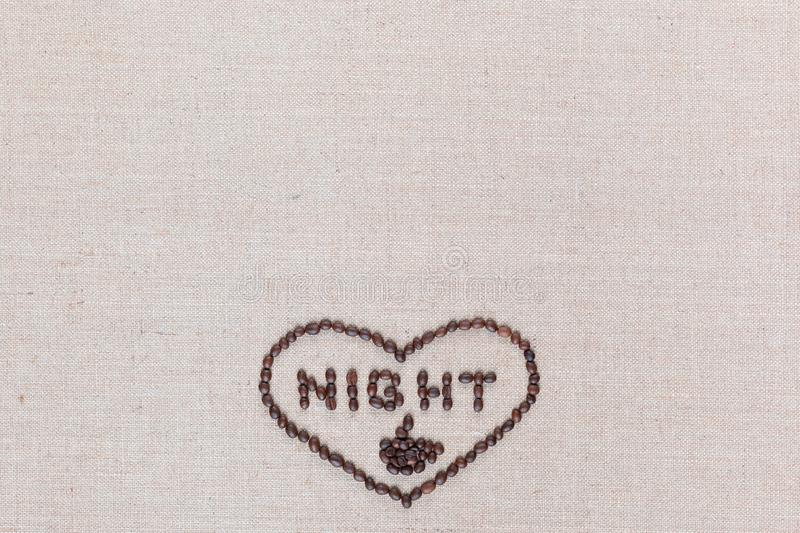 Night in heart sign from coffee beans isolated on linea texture, aligned bottom center stock image