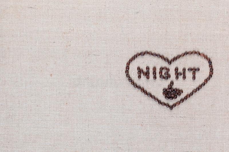 Night in heart sign from coffee beans isolated on linea texture, aligned middle right stock photography
