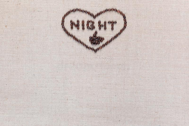 Night in heart sign from coffee beans isolated on linea texture, aligned top center stock photo