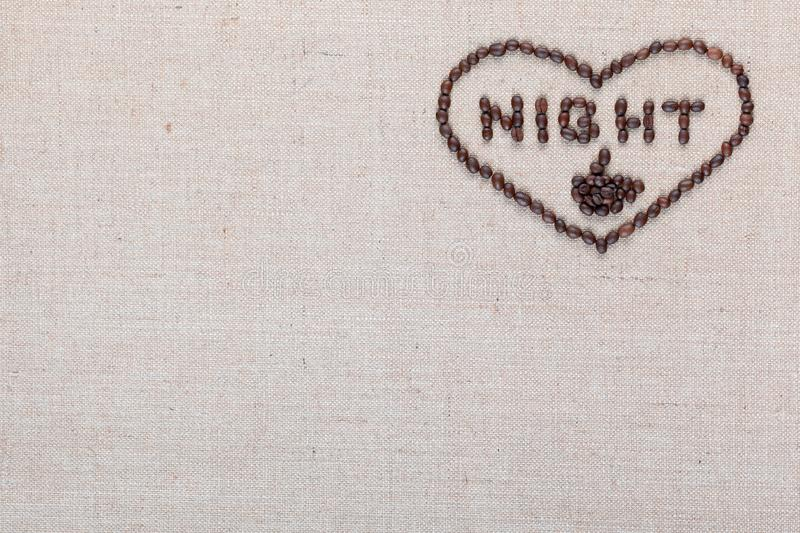 Night in heart sign from coffee beans isolated on linea texture, aligned top right royalty free stock images