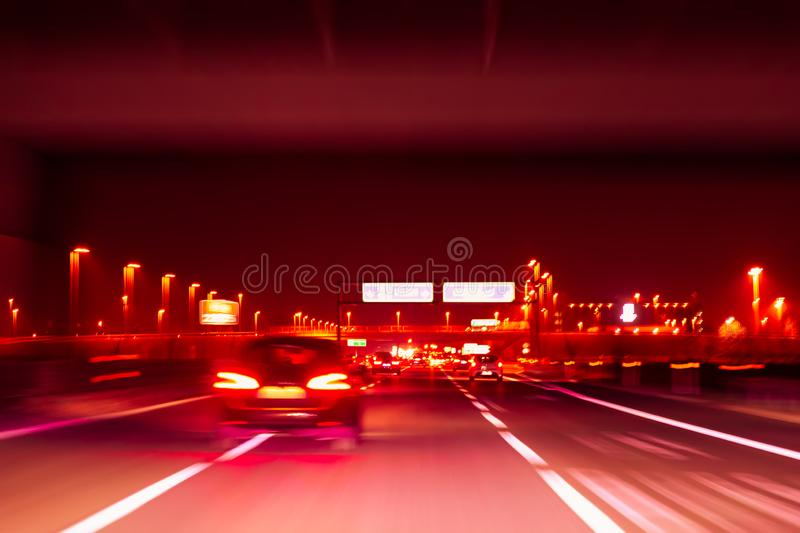 Night highway. Long exposure shot. Abstract blur image of road in the night time with bokeh for background. Speed effect. Night highway. Long exposure shot royalty free stock image