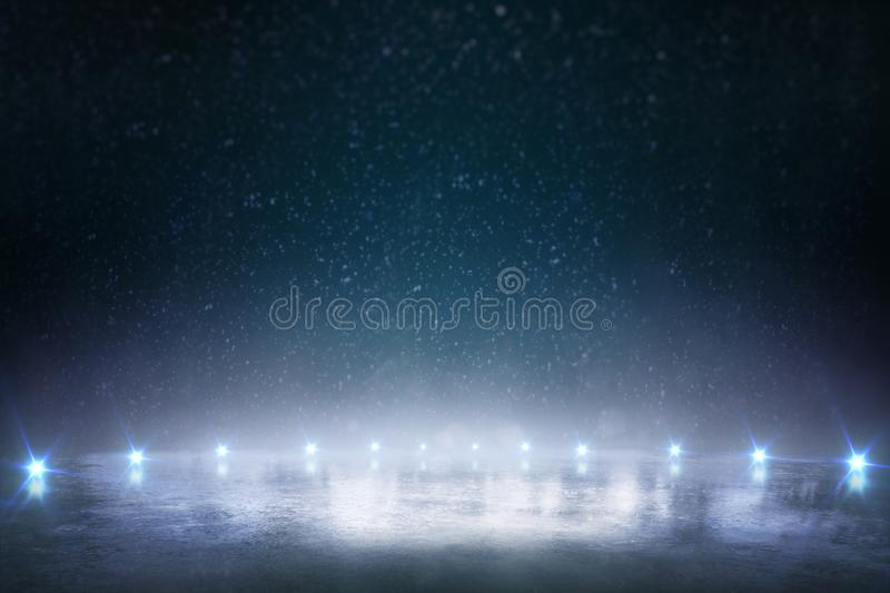 Night ice rink. Winter background with blue lights royalty free stock images