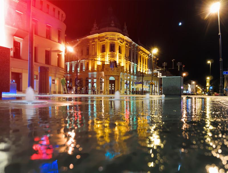 Night illuminated Lublin city in reflection wet center architecture street royalty free stock image
