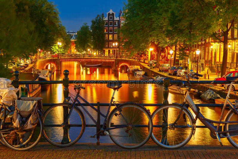 Night illumination of Amsterdam canal and bridge stock photos