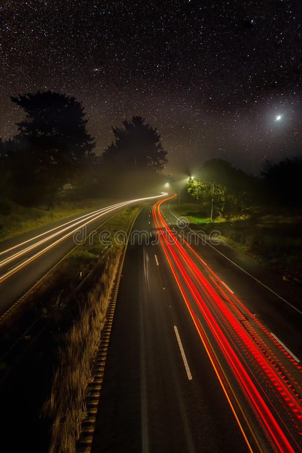 Night Image of Cars on a Highway Under the Stars stock image
