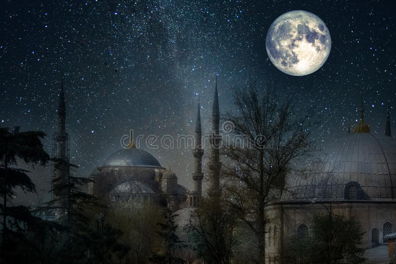 Night in Istanbul. Blue mosque under a starry sky. With a full moon and moon reflections on the roofs of buildings. Sultan Ahmed Mosque. Elements of this image royalty free stock photography