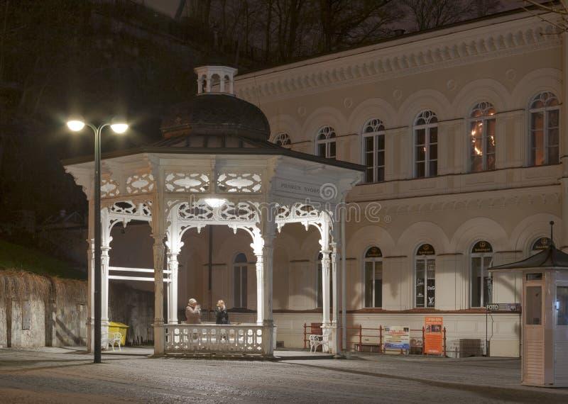 Night Karlovy Vary cityscape with Pramen Svoboda h royalty free stock image