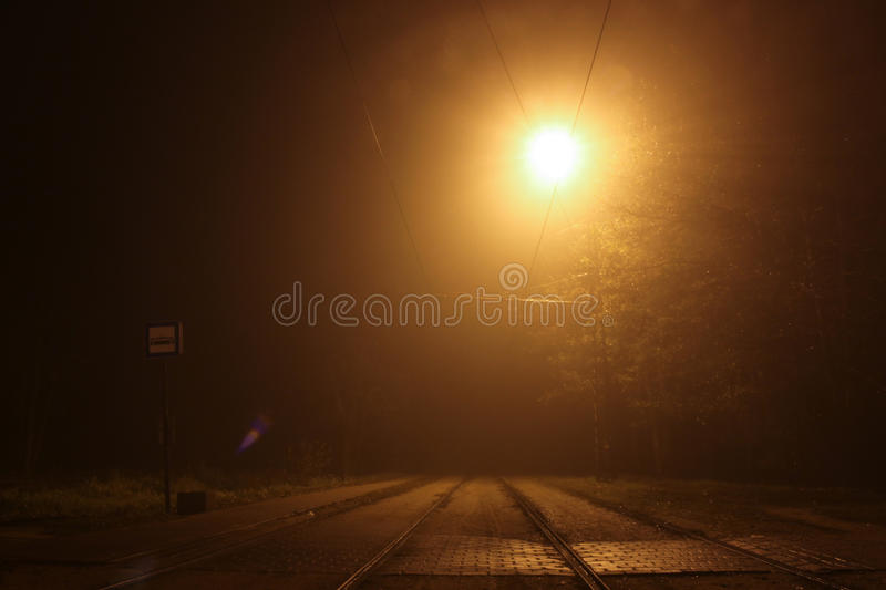 Night lamp light on the tram, train stop. Big yellow light out of street lights royalty free stock photos