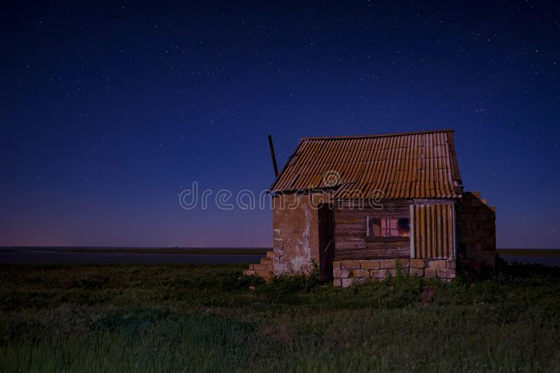 Night landscape with abandoned spooky house. Abandoned haunted house for night horror scene royalty free stock photos