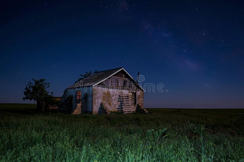Night landscape with abandoned spooky house. Abandoned haunted house for night horror scene royalty free stock image