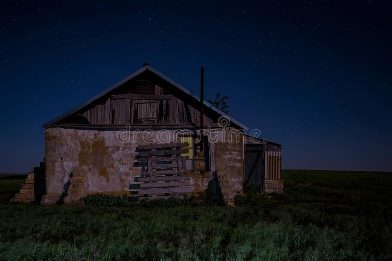 Night landscape with abandoned spooky house. Abandoned haunted house for night horror scene royalty free stock photo