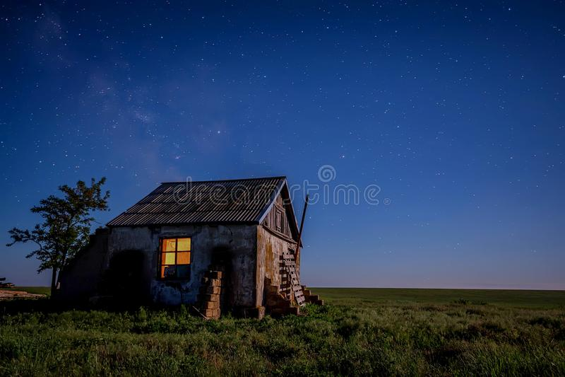 Night landscape with abandoned spooky house. Abandoned haunted house for night horror scene with milky way stock photo