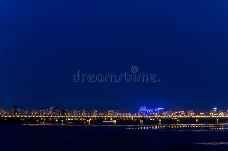 Night landscape of the city bridge in the lights. Night landscape of the city bridge over the river in the lights royalty free stock photo